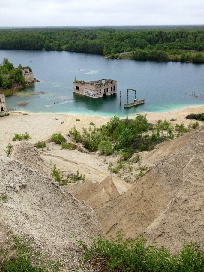 I climbed a quarry. In the rain water lake is a submerged Soviet factory. in the summer, you can jump off it and swim around.